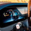 Luxury car dashboard with sunset reflections in the glass