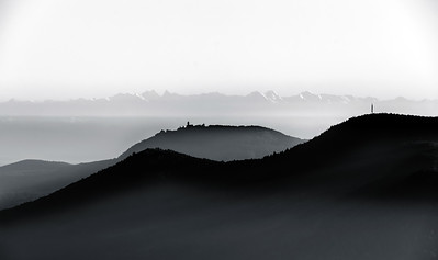 Aerial view of foggy mountains relief