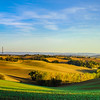 Beautiful green and yellow hills sunset panoramic view with shadows