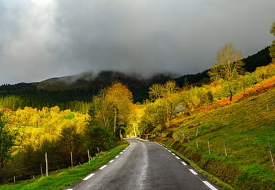 Beautiful empty road in Pyrenees. Autumn sunrise, shadows and colors of nature