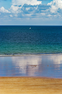 Low tide water on coastline, yellow sand of the beach, Bretagne
