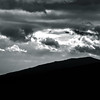 Silhouette of mountain on stormy sky background