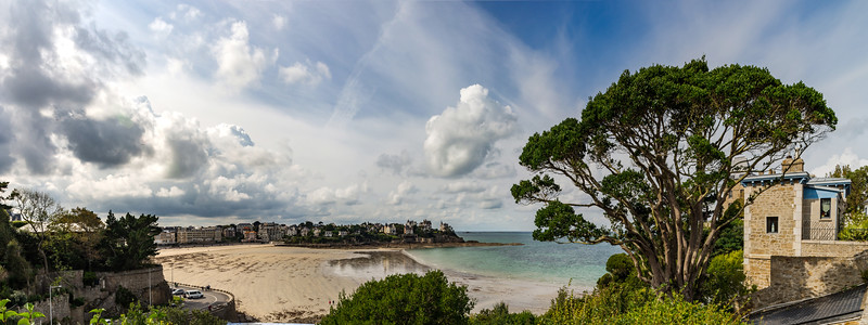 Coastline in old french city, Bretagne. Luxury villas and low tide water.