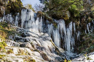 Beautiful icicles on mountain slope in Black Forest
