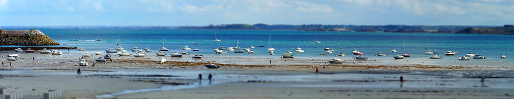 French resort autumn view. Yellow sand on long beach while low tide water, Brittany, France