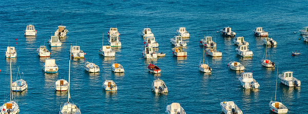 High resolution panoramic aerial view of little harbor with fishing boats
