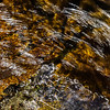 Abstract close-up view of ice in the river, winter in mountains