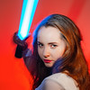 Spectacular young girl looks at the camera and brandishes her sword from Star Wars
