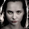 Emotional portrait of a young beautiful girl in Vogue style. Expressive eyes and energetic gaze. Advertising photography. Perfumes, cosmetics and fashionable style.