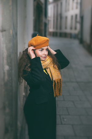 Emotional portrait of a young beautiful woman posing on the street.