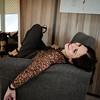 Beautiful young woman posing in a chair. Everyday clothes. Real emotions.