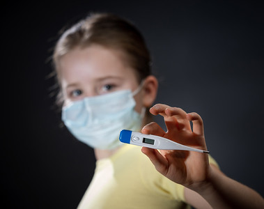 Girl in a medical protective mask. Coronavirus epidemic. Conceptual image. Stop the virus. Protective equipment.