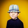 Red-haired expressive preschooler boy close-up emotional portrait