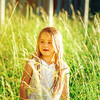 Cute little preschooler girl portrait in sunset forest