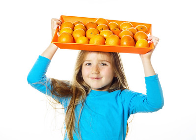Cute little girl with full tray of mandarins