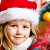 Cute little girl in red santa hat christmas portrait