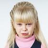Cute little towhead girl crying