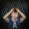 Schoolboy posing in sailor costume with emotions