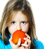Little girl eating date plum, closeup view