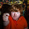 Red-haired funny boy showing fig sign