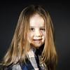 Cute little smiling girl close-up portrait