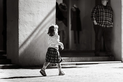 Little girl walking alone on the street
