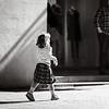 Little girl walking alone on the street