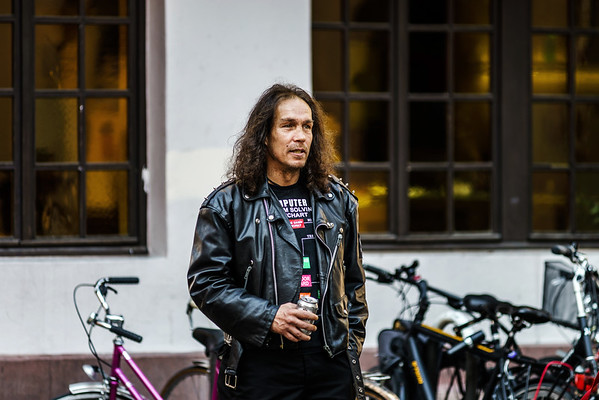 Editorial,24th September 2016: Strasbourg, France. Summer day in the touristic center of Strasbourg. Long haired man drinking beer