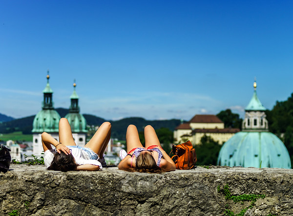 Rest of tourists, two girls laying on the sun