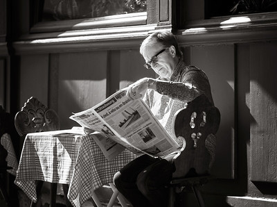 Editorial,24th September 2016: Strasbourg, France. Summer day in the touristic center of Strasbourg. Man reading newspaper in cafe