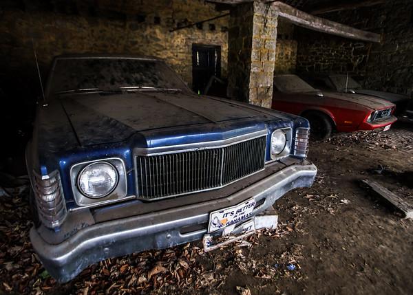 Old retro rusty car in village garage