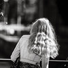 Blonde girl with beautiful hair walking on the street
