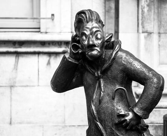 Funny bronze statue of man in Namur