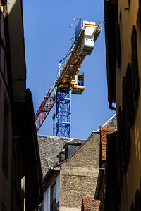 Big crane over the old center buildings