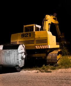 Old dirty excavator machine night view