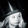 Cute little expressive girl posing with opera hat in old style
