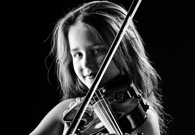 Cute litlle girl playing violin isolated portrait