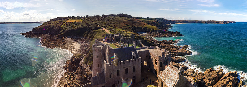 Old medieval french castle panoramic aerial view, coastline in Brittany