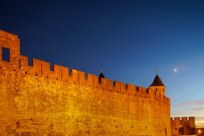 Carcassonne medieval fortress highlighted night view with moon in blue sky