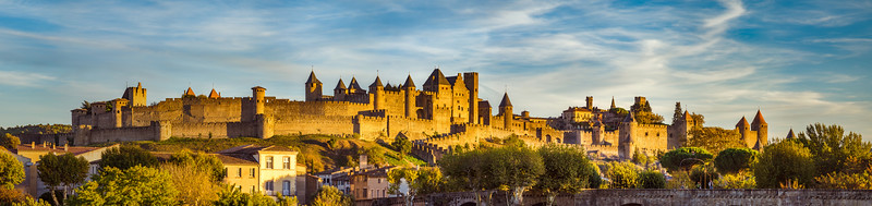 Carcassone medieval fortress panoramic view, sunset time