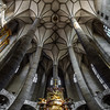 Very high medieval church with majestic ceiling. Interior.