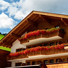 Balconies and terraces decorated with colorful potted flowers in an alpine resort in Austria