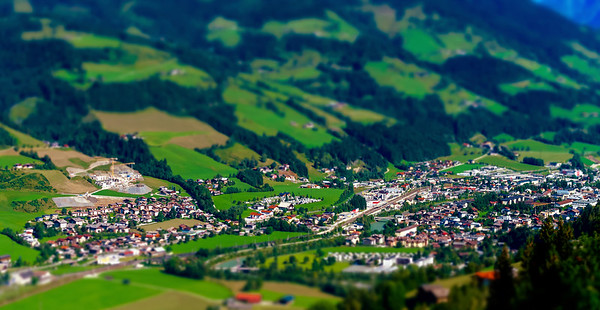 Tilt-shift aerial view of little austrian city in the valley