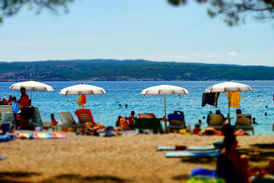 Tilt-shift beach view in warm weather on sea resort