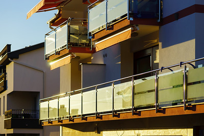 Balcony with glass wall in modern resort apartment