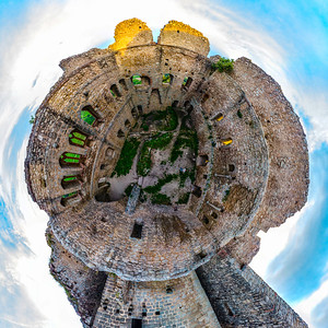 Little planet view of castle Ortenbourg in Alsace, France. Old medieval castle located on the top of the hill over the beautiful green valley