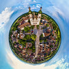 Majestic little planet view of little village Ebersmunster with big baroque church. Aerial drone view.