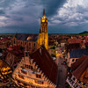 Aerial drone panoramic view of night highlighted village Dambach-la-Ville in Alsace.