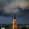 Dark sky and black clouds over the village Bergheim before the rain