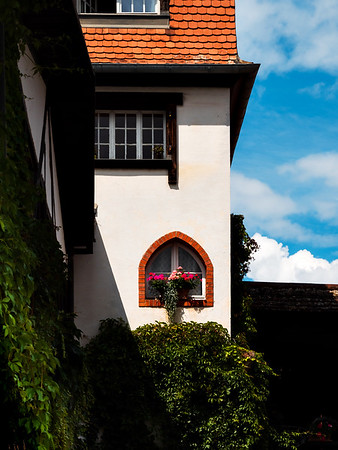 Alsace's sun-drenched gingerbread houses. Tiled roofs, flowers all around, the summer sun is shining. Beauty.